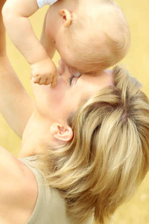 Small baby with mother outdoors. Summer Time. photo