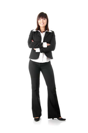adult  body writing: Confident business woman standing wearing elegant clothes - isolated over a white background  Stock Photo
