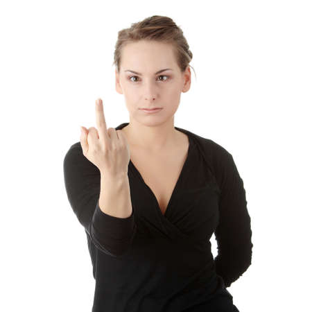 Angry girl showing middle finger.Isolated on white photo