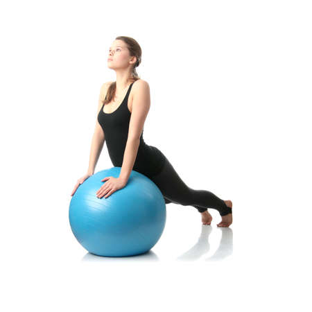 Young beautiful Woman während Fitness und Sport mit blue Ball, isolated on white background