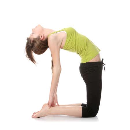 Teen girl exercising isolated on white background photo