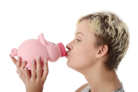 Young woman with piggy bank, isolated on white background photo
