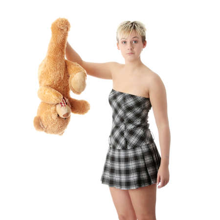 Punk teen girl with teddy bear, isolated on white background photo