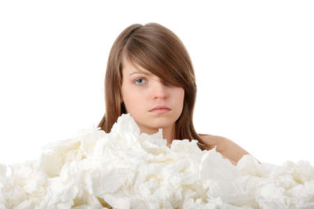 Ill teen girl with lot of tissues around photo