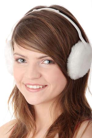 earmuff: Pretty young teen girl wearing white earmuff, isolated on white