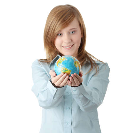Young teen girl holding globe, isolated on white background photo