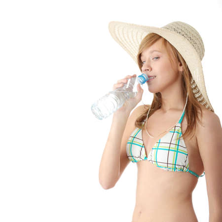 Summer girl with bottle of mineral water,isolated on white background Stock Photo - 6247258