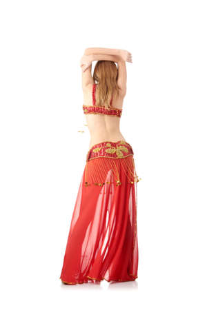 Teen girl in belly dancer costume dancing, isolated on white background photo