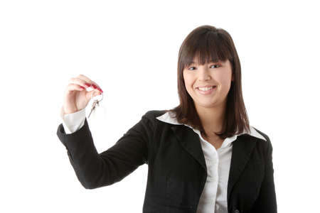 doorkey: Young businesswoman (real estate agent) with key