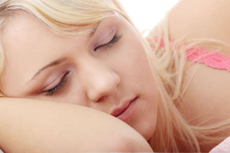 Blond teen woman in bed  photo