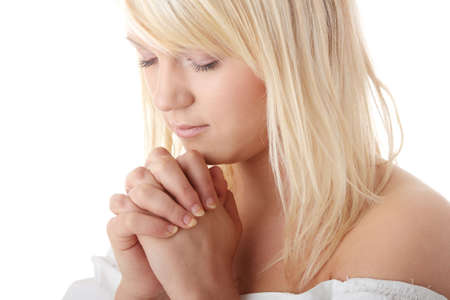 Closeup portrait of a young caucasian woman praying isolated on white background  Stock Photo - 6247331