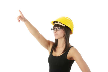 Engineer woman in yellow helmet isolated on white background  photo
