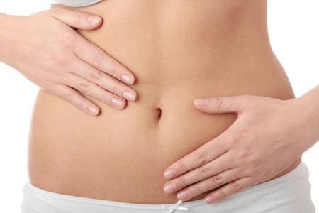 flat stomach: Mano sul ventre isolata on white background