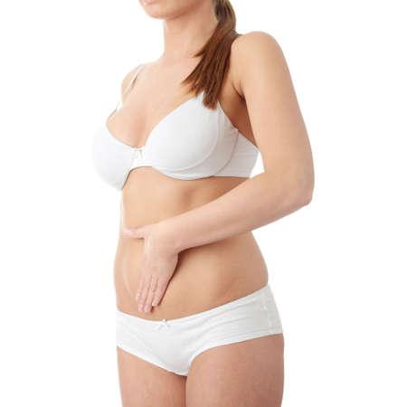 abdomen plano: Mano en el vientre aislado sobre fondo blanco