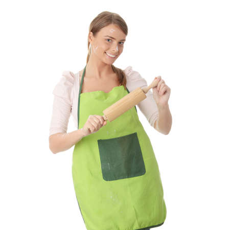 Young house wife in kitchen, isoalted on white background photo