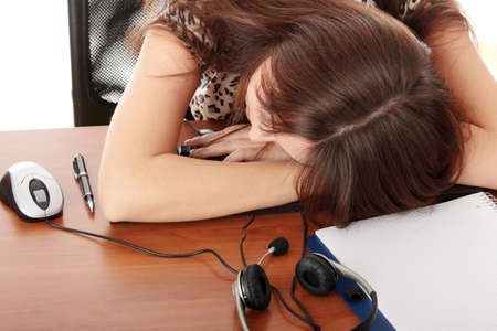 Young beautiful caucasian woman sleeping in call center work Stock Photo - 6271685