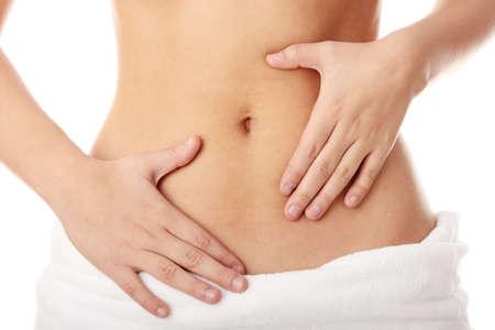 flat stomach: Mano sul ventre isolata on white background Archivio Fotografico