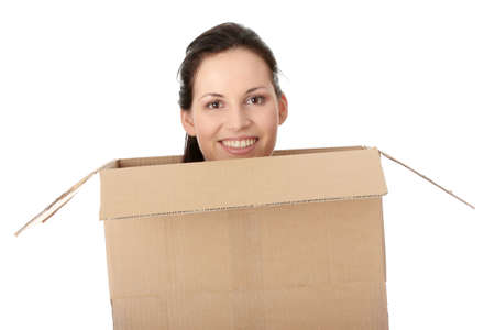 Thinking inside a box. Young business woman in cardboard box, isolated on white photo