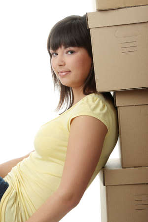 Young beautiful woman with packages for house moving (isolated on white) Stock Photo - 6300258