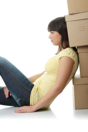 Young beautiful woman with packages for house moving (isolated on white) Stock Photo - 6320974