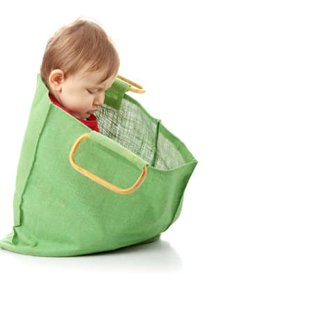 Baby girl in shopping bag, isolated on white Stock Photo - 6350953