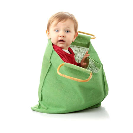 Baby girl in shopping bag, isolated on white Stock Photo - 6350955