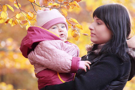 Mother and Child in yallow autumn forest Stock Photo - 6350943