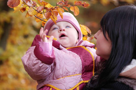 Mother and Child in yallow autumn forest Stock Photo - 6350952