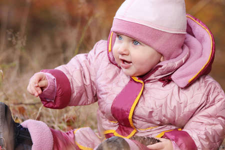 Small baby in forest sitting at fall   Stock Photo - 6350954