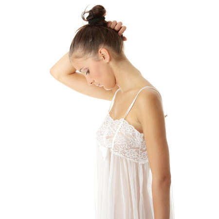 Young woman in sexy night lingerie isolated photo
