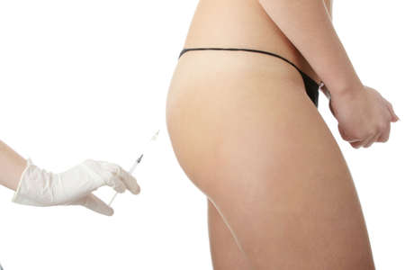 Woman getting botox injection (butt) Stock Photo - 6302319