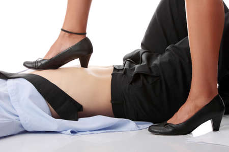 Woman leg on man belly - who is the boss concept Stock Photo - 6302264
