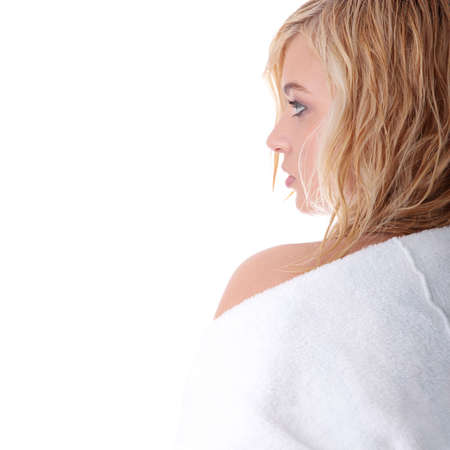 Young beautiful blond teen woman dressed in white bathrobe Stock Photo - 6343432