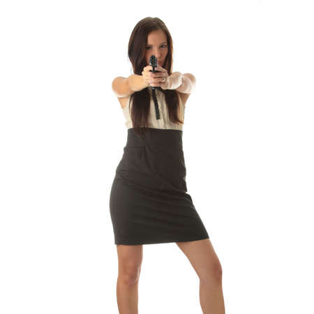 Young woman with hand gun isolated on white bacground  Stock Photo - 6343425
