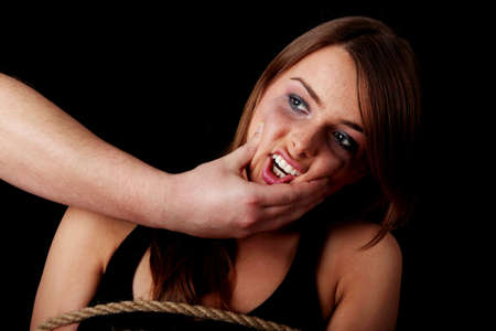 Emotional portrait of abused woman isolated on black    Stock Photo - 6351121