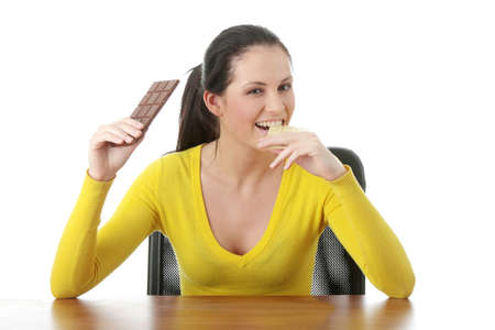 Portrait of young happy smiling woman eating dark and white chocolate Stock Photo - 6376402