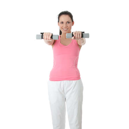 Beautiful young woman doing exercise with dumb bells , isolated  photo