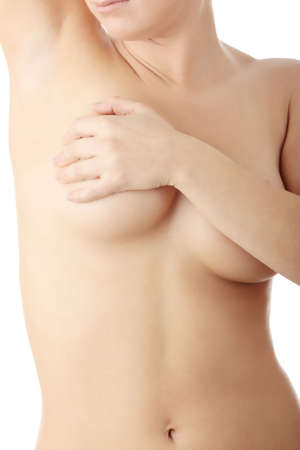 breast examination: Breast cancer - Woman holding her breast