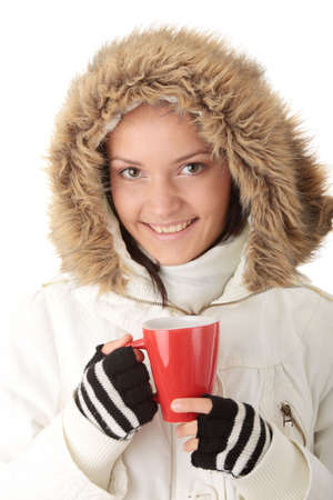 Teen winter girl with heart shaped red cup of hot drink (tea,coffee or milk)  Stock Photo - 6439188