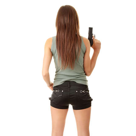 female assassin: Young caucasian woman with gun, isolated on white background Stock Photo