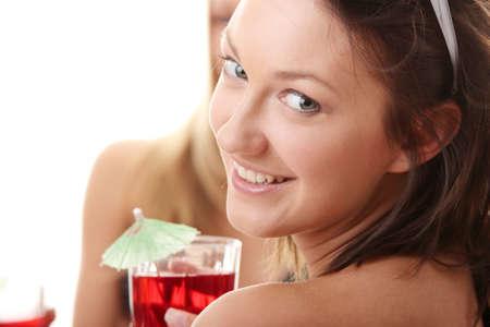 Two girlfriends in bikini, with drinks, talking photo