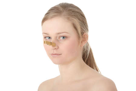 Portrait of young caucasian woman with Clothespin on her nose - bad smell concept photo