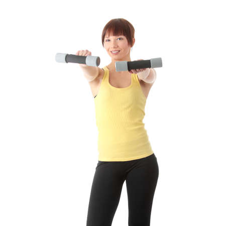 Portrait of beautiful smiling girl with dumbbells.  photo