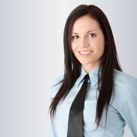 Young worker woman, over gray background photo