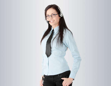 personal call: Young call cener worker, over gray background Stock Photo