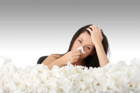 Young woman in lot of tissues around, ill Stock Photo