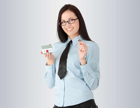 Young businesswoman  (real estate agent) with hose model and kays Stock Photo - 6475360