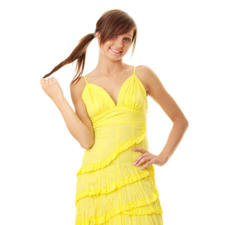 Beautiful brunette girl in yellow dress. Isolated on white background   photo