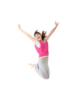 Dancing woman in pink and happy smiling facial expression jumping up.  photo