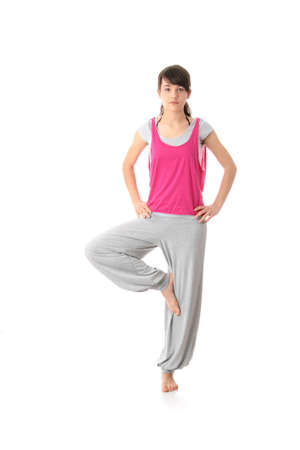 Teen woman training yoga, isolated on white photo